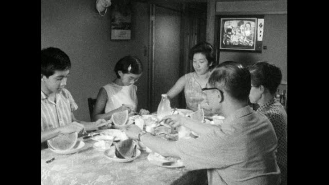 family sits at a table and eats breakfast together; 1966 - stereotypically middle class stock videos & royalty-free footage