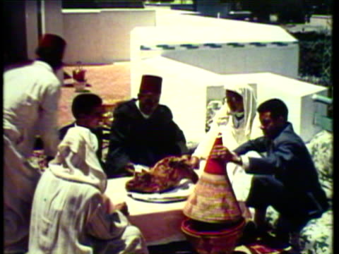 1953 ms pan family sits down to meal of lamb and naan / casablanca, morocco / audio - food and drink stock videos & royalty-free footage