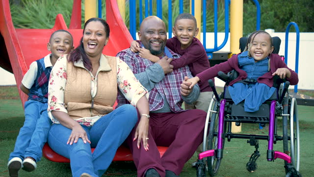 family sits on playground, girl in wheelchair, twin boys - 4 5 years stock videos & royalty-free footage