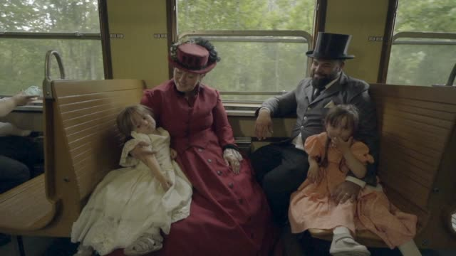 family sitting and talking on a moving steam train car - victorian stock videos & royalty-free footage