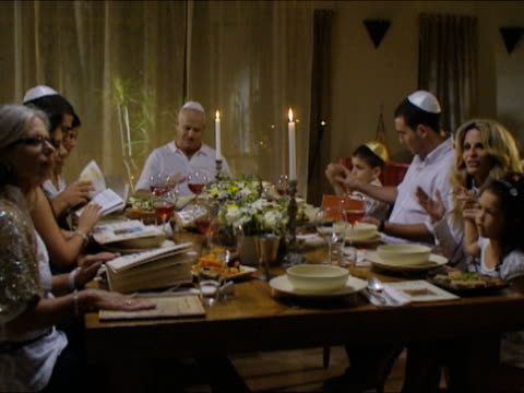 ms pan family sitting at dinner table at seder night during passover / beit yitzhak, israel - passover stock videos and b-roll footage