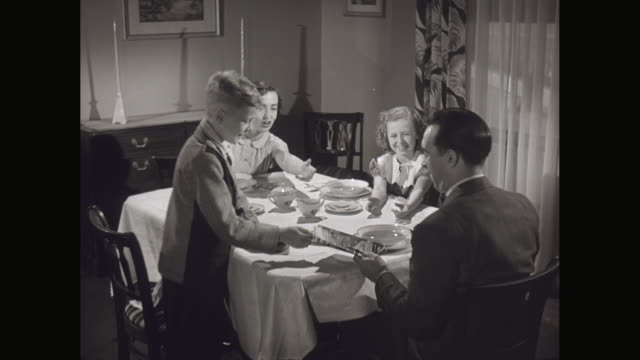 ms family sitting at the dining table / united states - two parents stock videos & royalty-free footage
