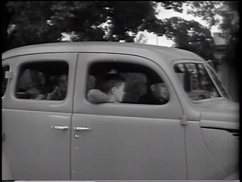 B/W 1937 family sitting in Ford V-8 Standard sedan / commercial