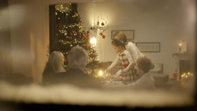 family sitting on christmas table - christmas stock videos & royalty-free footage