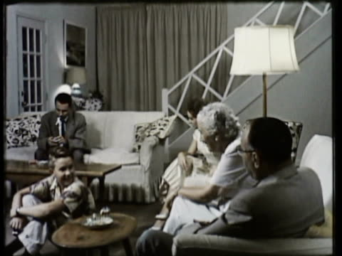 1955 ms b/w family sitting on couch talking / usa - 1955 stock videos & royalty-free footage