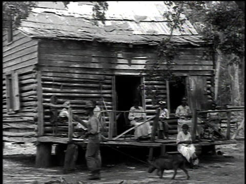 1916 montage family sitting on the porch of a cabin weaving baskets / democratic republic of congo - democratic republic of the congo stock videos & royalty-free footage