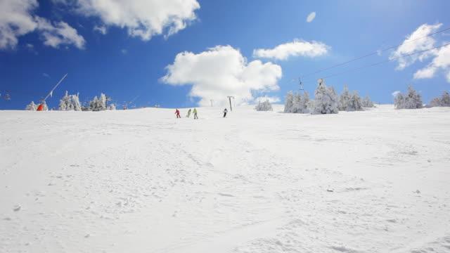Family skiing on the mountains.