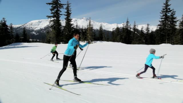 ms ts family skiing  / whistler, bc, canada   - スキー板点の映像素材/bロール