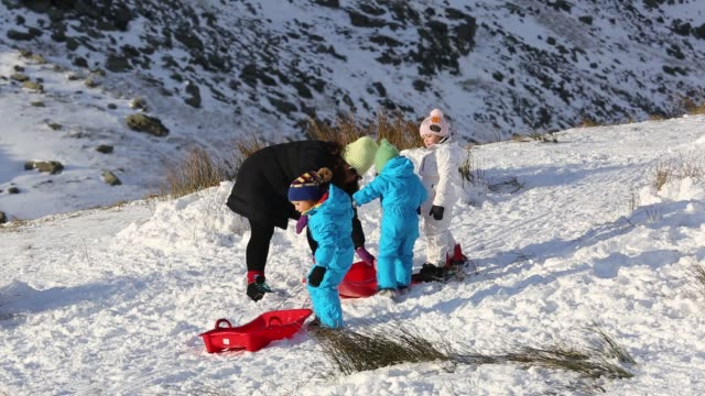 family sledging on kirkstone pass in the lake district, cumbria, uk. - cold temperature stock videos & royalty-free footage
