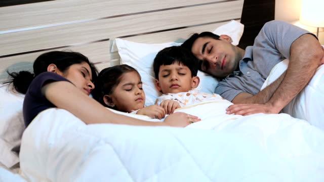 family sleeping at home, delhi, india - duvet stock videos & royalty-free footage