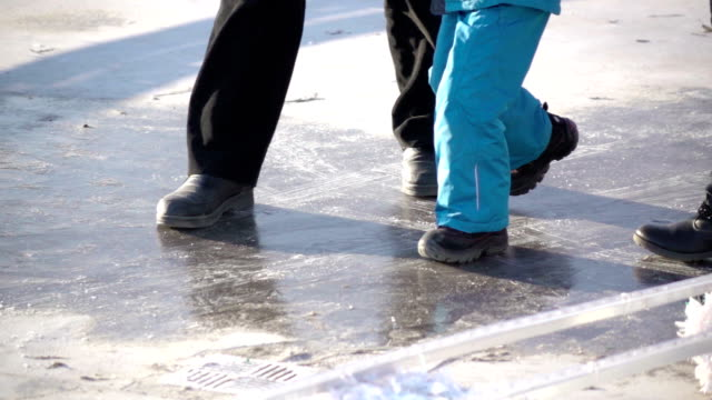 Family sliding on the ice