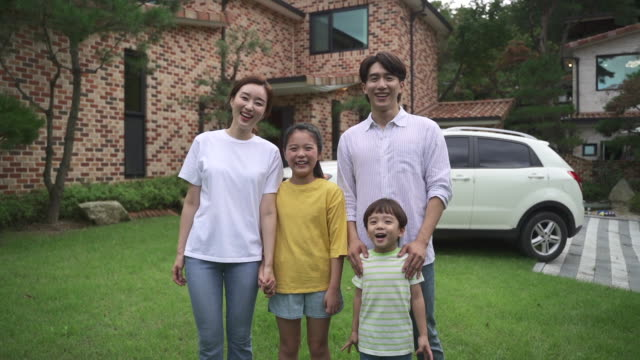 family smiling brightly in the courtyard - courtyard stock videos & royalty-free footage