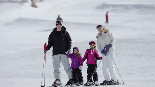 family snow skiing at a ski resort - ski stock videos & royalty-free footage