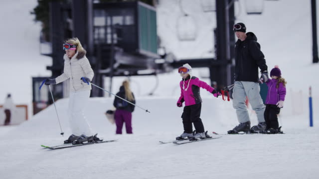 family snow skiing at a ski resort - skiing stock videos & royalty-free footage