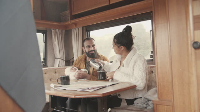 family spending leisure time in motor home - two parents stock videos & royalty-free footage