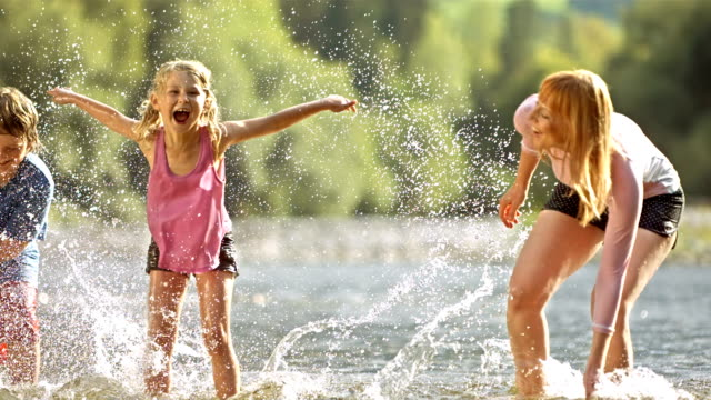family splashing each other (super slow motion) - adventure stock videos & royalty-free footage