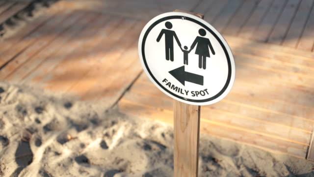 family spot information sign on the beach - information sign stock videos & royalty-free footage