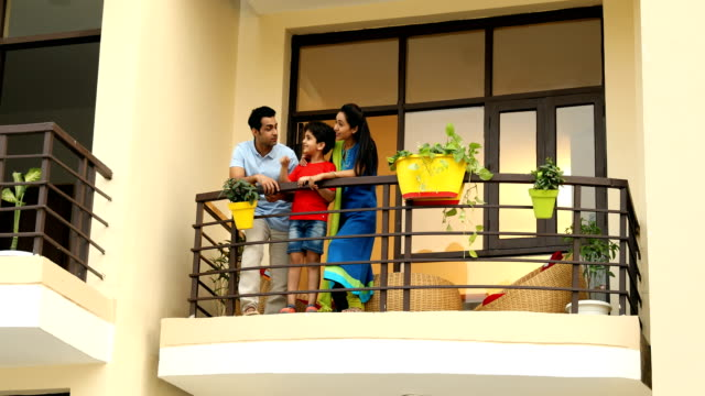 ms pan family standing and talking in balcony / sonipat, haryana, india - image stock videos & royalty-free footage