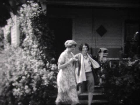 1931 family stepping off front porch