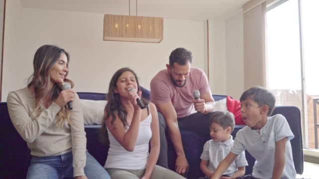 family sung karaoke and eating pop corns - singing stock videos & royalty-free footage