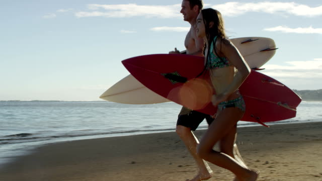 Family surfing on a tropical beach vacation to Hawaii