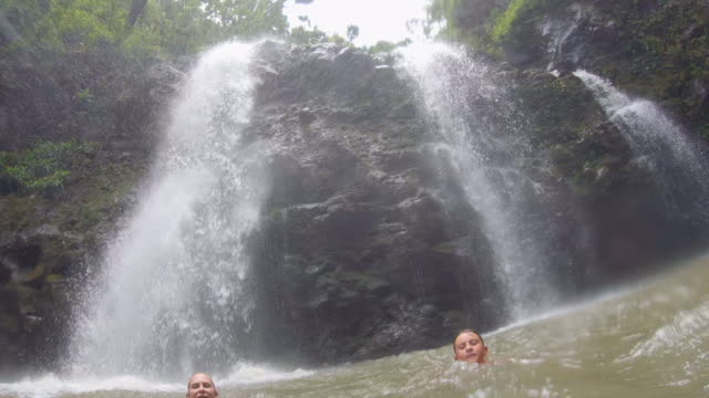 a family swimming near upper waikani falls waterfall in maui, hawaii. - slow motion - number 3 stock videos & royalty-free footage