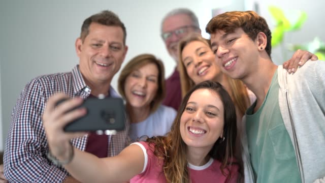 family taking a selfie at home - teenage boys stock videos & royalty-free footage