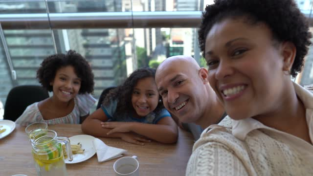 family taking a selfie at home - mid adult stock videos & royalty-free footage