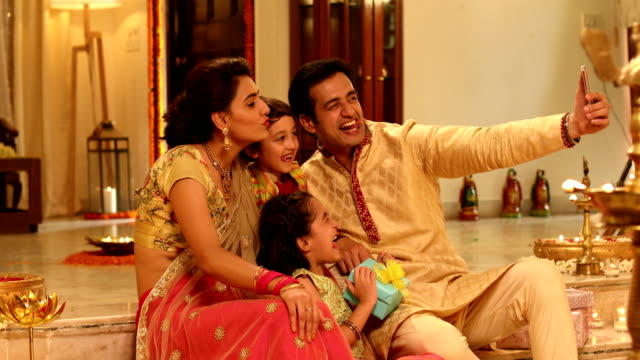Family taking selfie with a mobile phone, Delhi, India