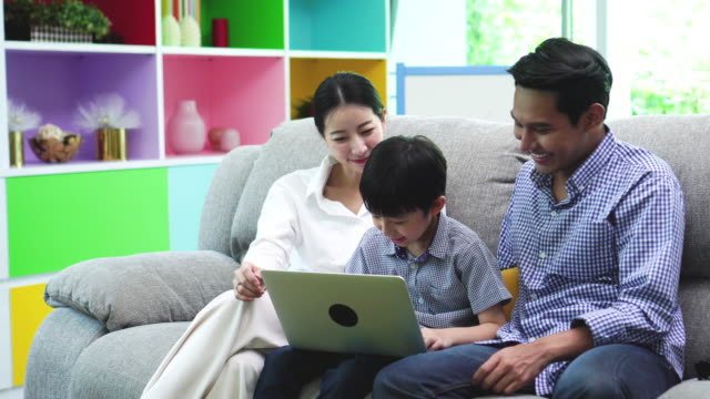 family teach boy to use technology - adult imitation stock videos and b-roll footage
