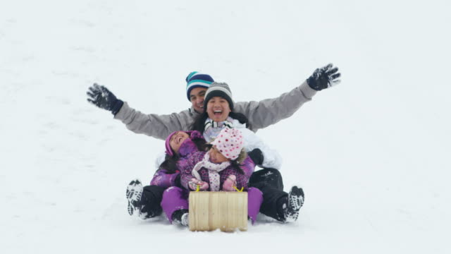 family tobogganing - filipino ethnicity stock videos & royalty-free footage
