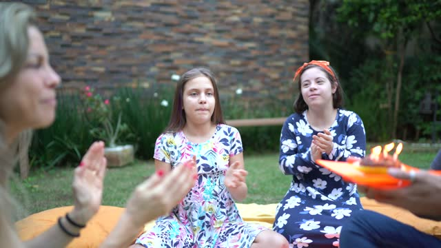 family together doing picnic and celebrating birthday in the backyard at home - intellectual disability stock videos & royalty-free footage