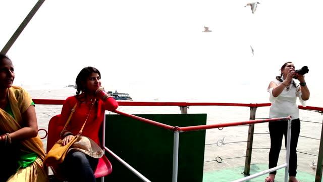 family travel by ferryboat, mumbai - human body part video stock e b–roll