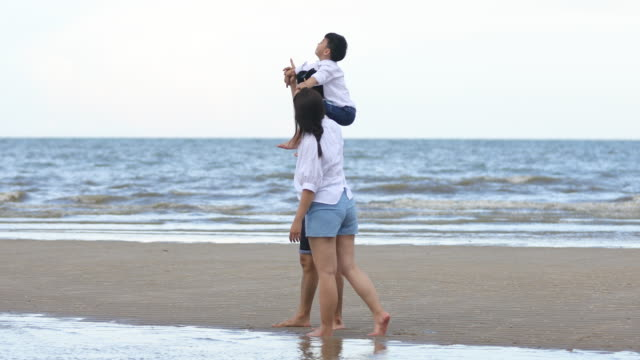 Family travel on vacation for relax and play happily at the beach.