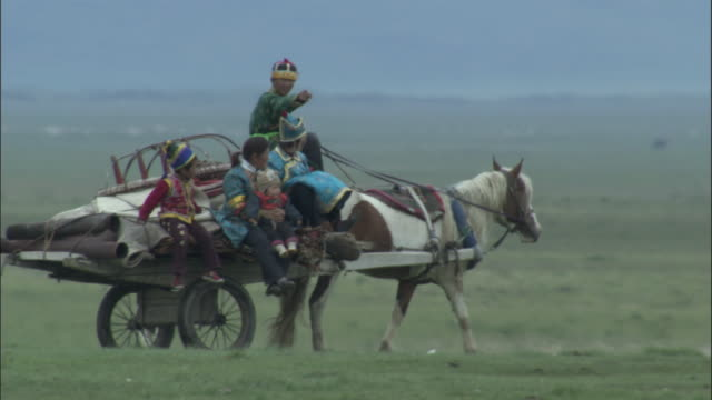 family travel on wagon carrying collapsed ger , bayanbulak grasslands. - girls videos stock videos & royalty-free footage