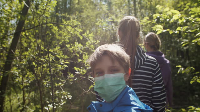 family trying to enjoy spring during covid-19 pandemic - four people stock videos & royalty-free footage