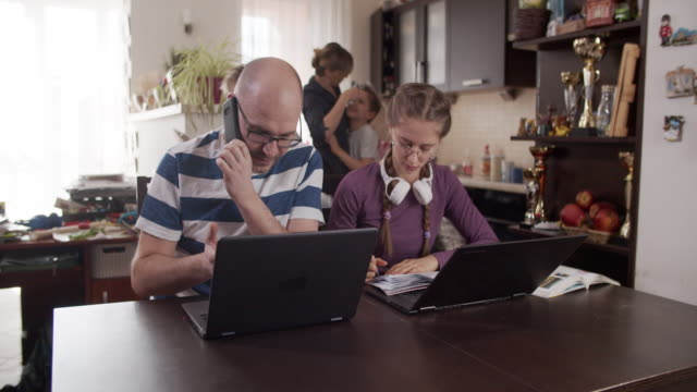 family trying to work and learn at home - two parents stock videos & royalty-free footage