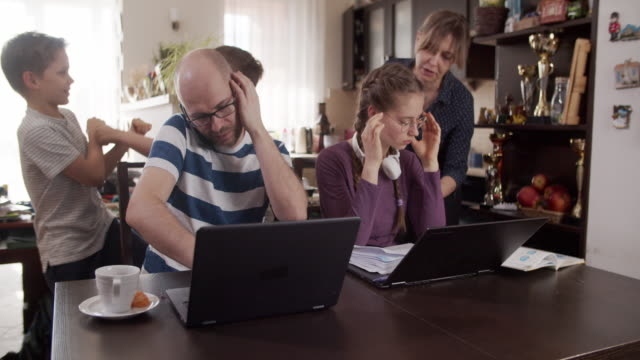 family trying to work and learn at home - emotional stress stock videos & royalty-free footage