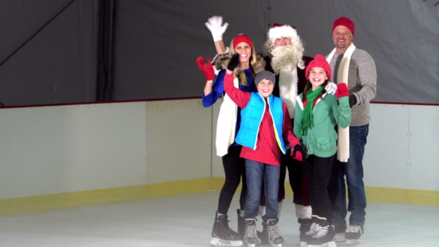 family, two children at ice skating rink with santa - 10 11 years stock videos & royalty-free footage