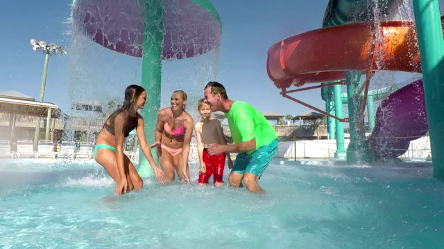 family, two children having fun at water park splashing - 10 11 years stock videos and b-roll footage