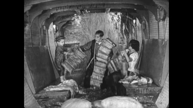 1921 family unsuccessfully attempt to put on lifejackets as their leaking boat fills with water - 1921 stock videos & royalty-free footage