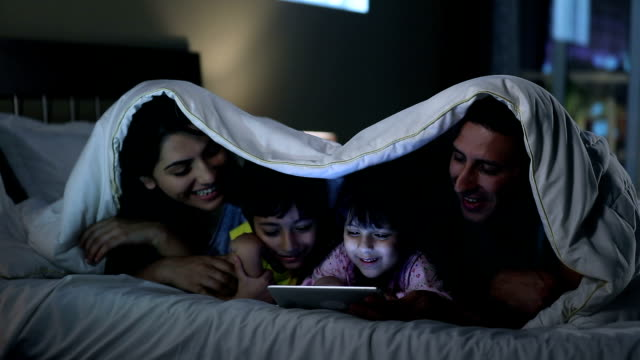 family using digital tablet at home, delhi, india - behaglich stock-videos und b-roll-filmmaterial