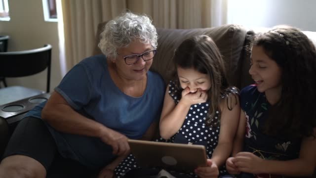 family using tablet at home - sibling stock videos & royalty-free footage