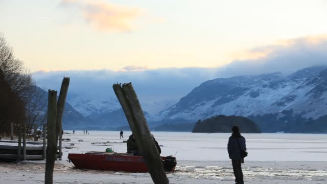 family using their boat to keep a channel clear on a frozen derwent water, so they can still access their house on an island in the lake, keswick,... - cold temperature stock videos & royalty-free footage