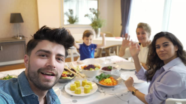 family video conferencing during dinner - evening meal stock videos & royalty-free footage