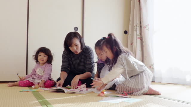 family - folding paper stock videos and b-roll footage