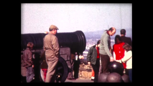 1973 family visits large cannon and cannon balls in edinburgh - edinburgh scotland stock videos & royalty-free footage