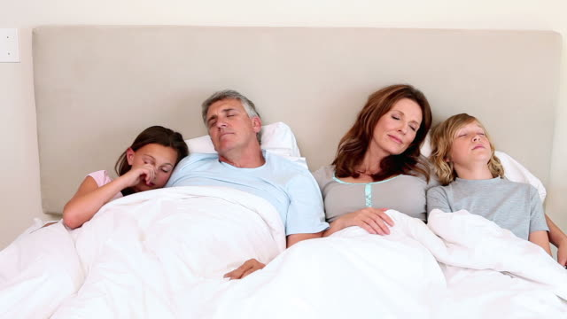 Family waking up together