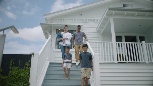 family walk down the front steps of their new home - family with three children stock videos & royalty-free footage