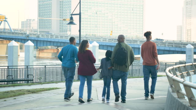 family walking along city waterfront - 14 15 years stock videos & royalty-free footage